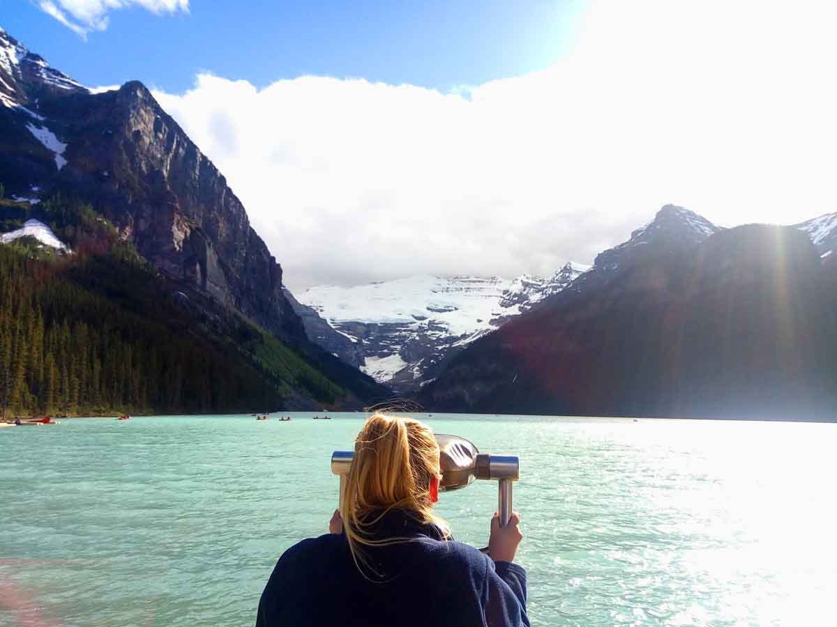 Yvette Morrissey looking through the binoculars at the magnificent Lake Louise in Alberta