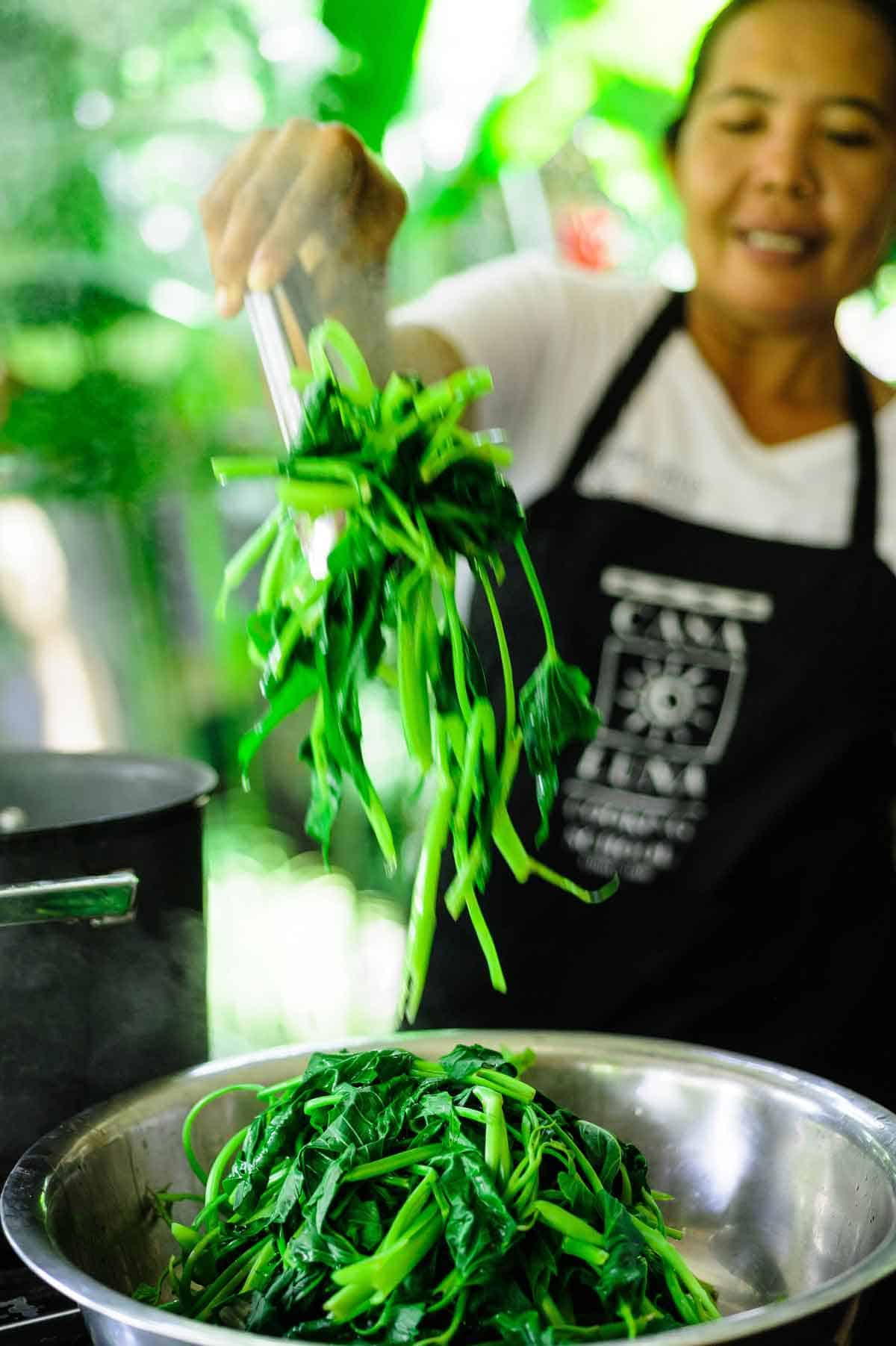 A Balinese chef puts on a demonstration for her students at the Casa Luna Cooking School in Ubud, Bali
