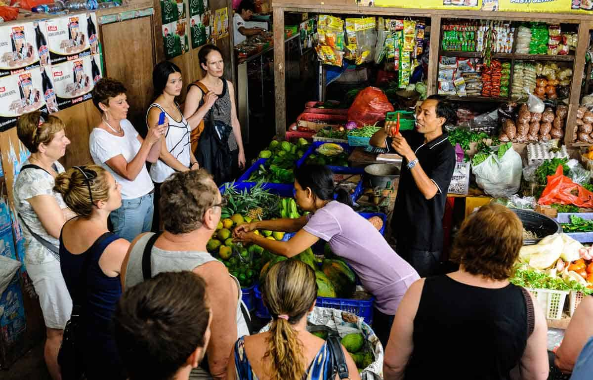 Students visit a local market in Bali to gather ingredients for the Casa Luna Cooking School