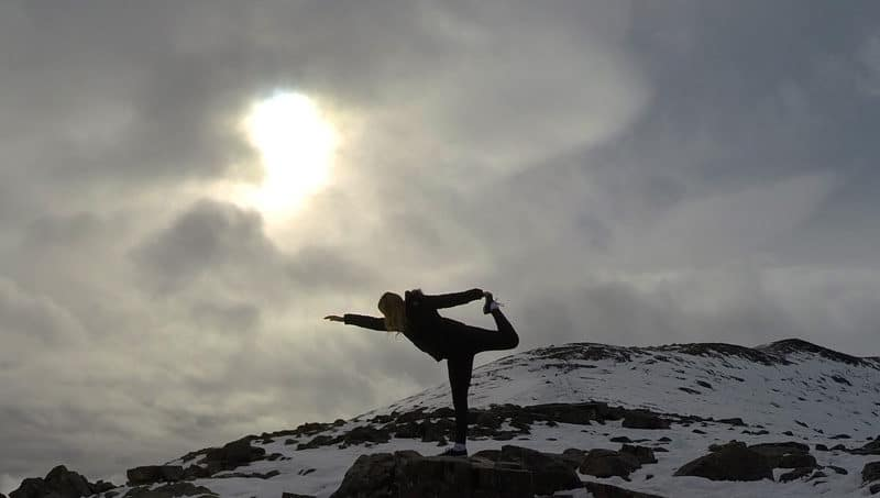 Doing dancers pose at Whistlers Mountain summit in Jasper, Alberta