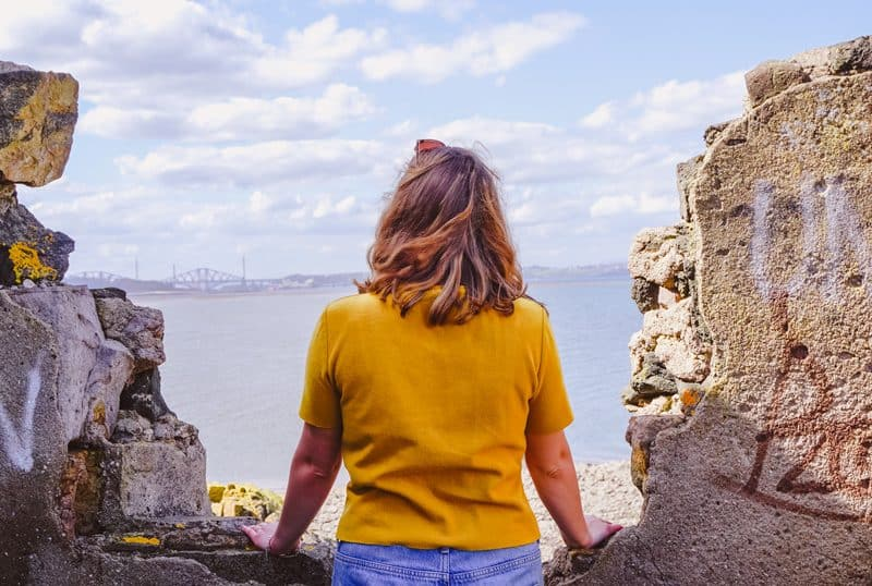 Girl looking out to the Firth of Forth on a clear sunny day