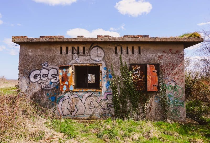 Military building in ruins covered in graffiti on Cramond Island