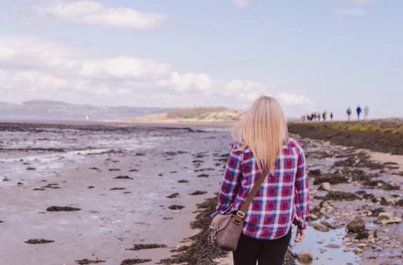 Yvette Morrissey walking along the causeway that leads to Cramond Island