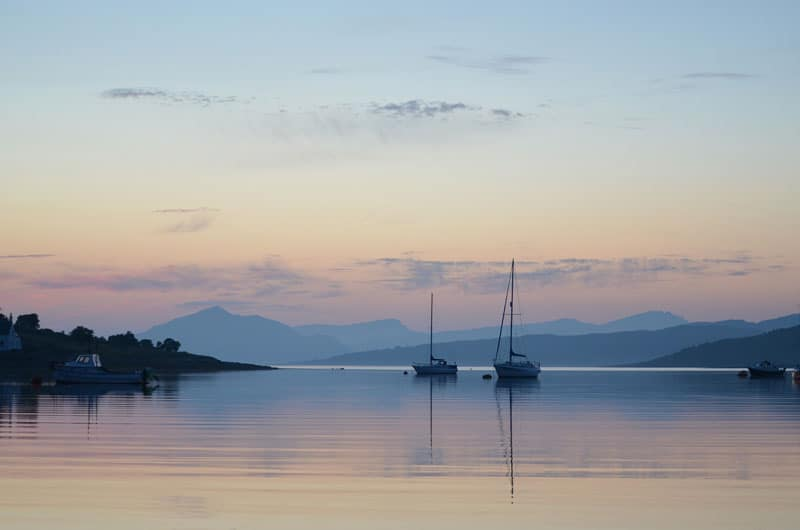 Boats on the loch at sunset in Scotland